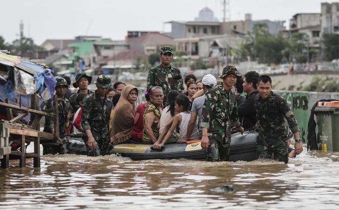 Fleeing flooded Jakarta