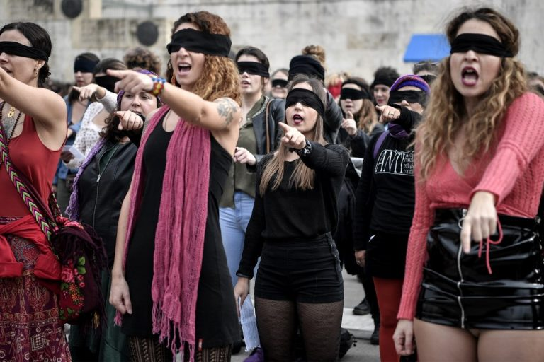 Female activists perform a choreography originated in Chile, and inspired by the Chilean feminist group Las Tesis, to protest against gender violence and patriarchy. Photo by LOUISA GOULIAMAKI / AFP