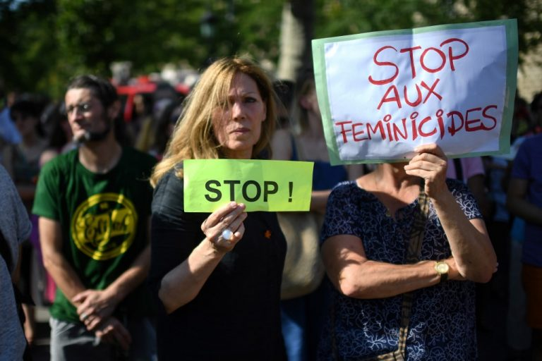 "Women display signs during a demonstration against ""violences against women"" in Paris, on July 6, 2019 (Photo by Martin BUREAU / AFP)"