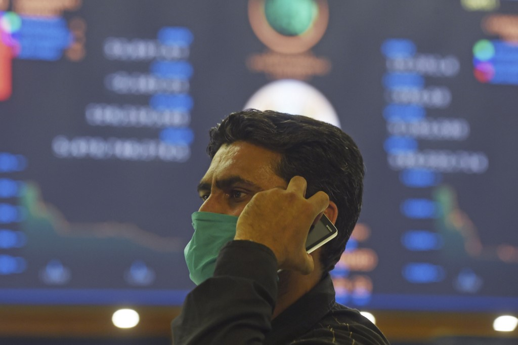 A stockbroker during a trading session at the Pakistan Stock Exchange in Karachi on March 16, 2020. (Photo by Asif HASSAN / AFP)