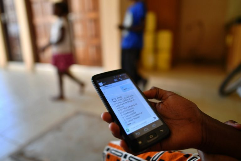 In Kenya, students use a platform to receive lessons via SMS without internet access. (Photo by TONY KARUMBA / AFP)