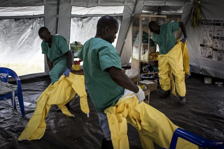 A medical team in an Ebola treatment center managed by the Alliance for International Medical Action (ALIMA) on August 11, 2018 in Beni, northeastern DRC. (Photo by John WESSELS / AFP)