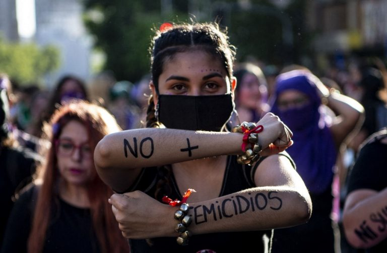Women marching during the International Day for the Elimination of Violence against Women in Santiago, Chile on November 2020. Photo by Martin Bernetti / AFP