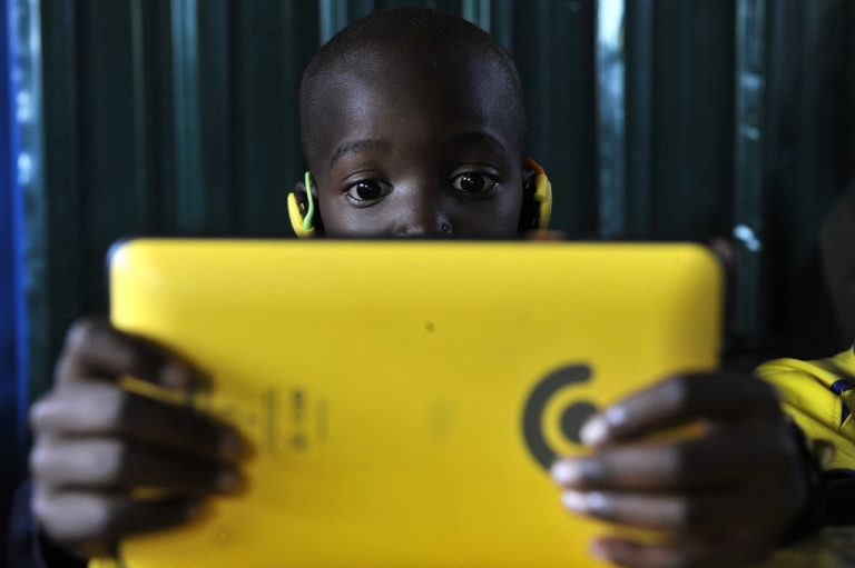 A pupil using a Kio tablet during a class session in Kawangware, Nairobi on October 2015. Photo by Simon MAINA / AFP